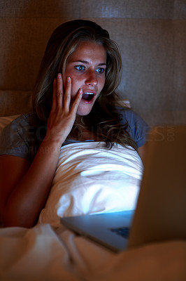 Buy stock photo Portrait of a surprised teenage girl looking at laptop while lying on the bed at home
