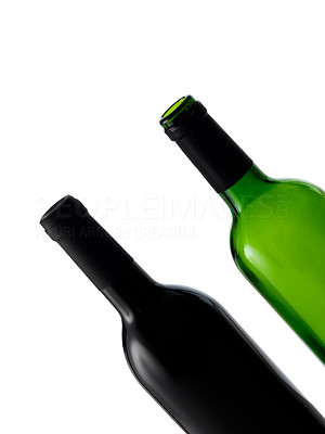Buy stock photo Isolated shot of two wine bottles, one red and one white.