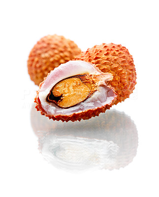 Buy stock photo Shot of an isolated orange lychee