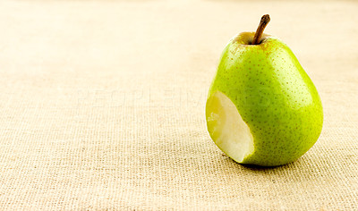 Buy stock photo Shot of a green pear