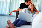 Romantic young couple sitting with laptop
