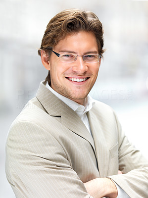 Buy stock photo Cheerful young businessman wearing glasses