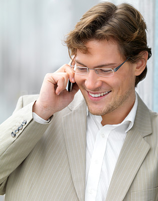 Buy stock photo Young business man talking about work on his mobile phone