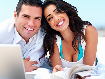 Buy stock photo Portrait of a happy young couple holding book