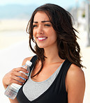 Smiling young woman with water bottle