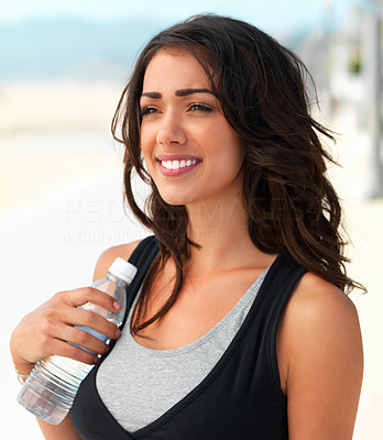 Buy stock photo Close up of a smiling young woman with water bottle