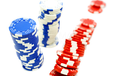 Buy stock photo Two leaning stacks of blue and white poker chips and one spilled stack of red chips