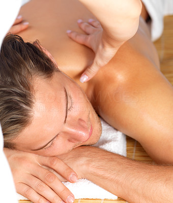 Buy stock photo Close-up of a happy man relaxing while woman giving back massage