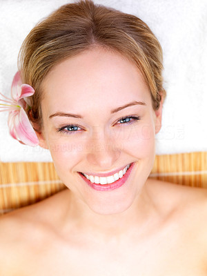 Buy stock photo Close-up of a beautiful girl smiling, lying on a mat at the day spa