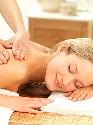 Buy stock photo Relaxing at the massage therapist - Close-up of a woman receiving a shoulder and back massage
