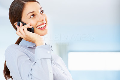 Buy stock photo Young attractive businesswoman talking on cellphone and smiling