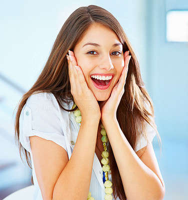 Buy stock photo Portrait of young surprised girl holding her face and smiling