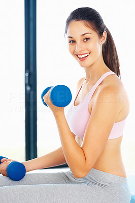 Buy stock photo Portrait of pretty young girl lifting dumbbells and smiling