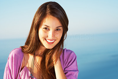 Buy stock photo Closeup of beautiful young girl smiling against sky