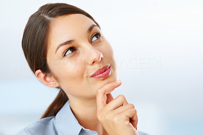 Buy stock photo Closeup of cute young businesswoman looking above and daydreaming
