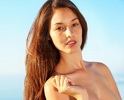 Buy stock photo Closeup of young woman standing against sky and giving you sensual look