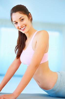 Buy stock photo Portrait of young woman exercising on mattress and smiling