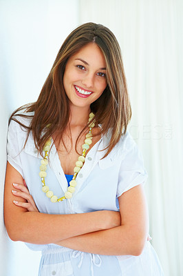 Buy stock photo Attractive young woman leaning against wall and smiling