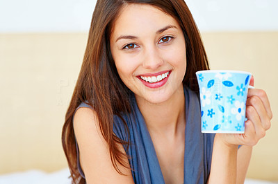 Buy stock photo Closeup of attractive young woman with coffee mug and smiling