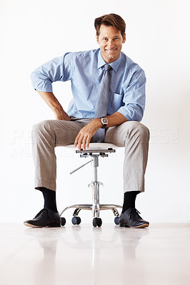 Buy stock photo Portrait of a successful young businessman sitting on the chair