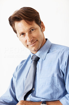 Buy stock photo Portrait of a handsome young businessman staring at you over white background