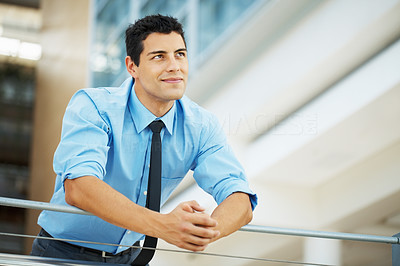 Buy stock photo Male executive standing and looking up at copyspace