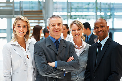Buy stock photo Business people smiling with colleagues in background
