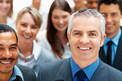 Buy stock photo Mature business man smiling with team behind him