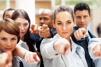 Buy stock photo Serious diverse group of executives all pointing at you