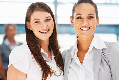 Buy stock photo Happy business women standing next to each other
