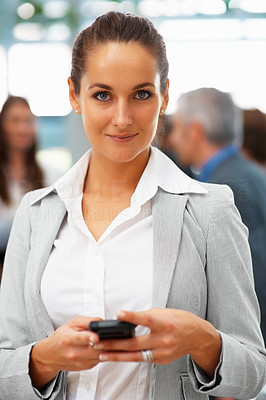 Buy stock photo Beautiful female executive holding cell phone