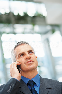 Buy stock photo Thoughtful business man listening to call on cell phone