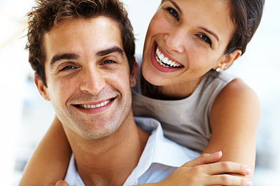 Buy stock photo Closeup portrait of young beautiful couple smiling together and hugging