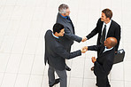 Business men shaking hands to say hello