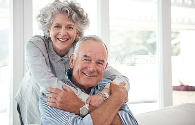 Buy stock photo Cropped portrait of an affectionate senior couple at home
