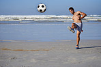 Getting a bit of football into his beach day!