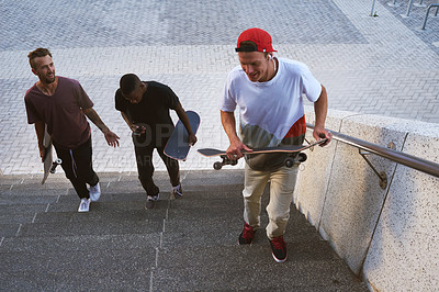 Buy stock photo Shot of a group of skaters walking together