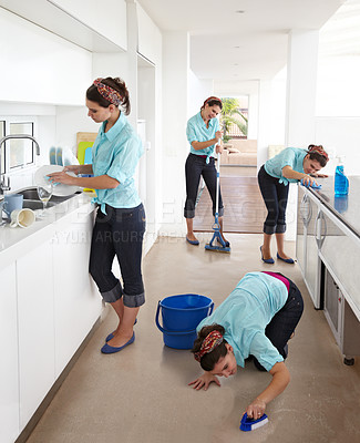 Buy stock photo Multiple clones of one young woman cleaning a kitchen