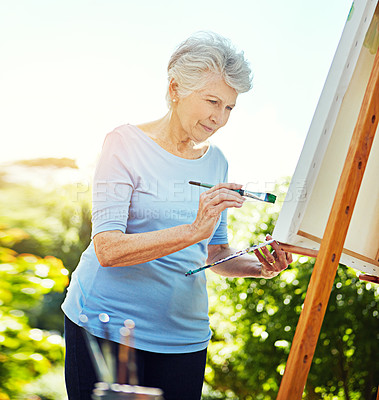 Buy stock photo Cropped shot of a senior woman painting in the park