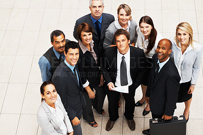 Buy stock photo Top view of colleagues looking up and smiling