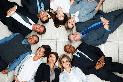 Buy stock photo Top view of executives lying on floor in circle, looking upwards