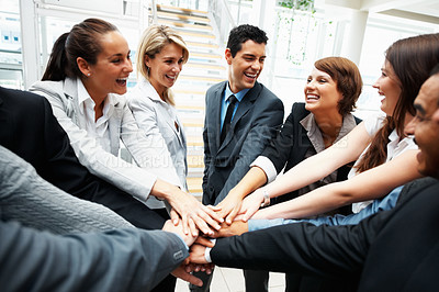 Buy stock photo Happy colleagues with hands piled on top of one another
