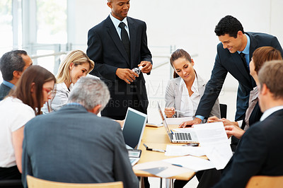 Buy stock photo Group of multi ethnic executives discussing during a meeting