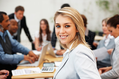 Buy stock photo Pretty business woman with colleagues working on project in background