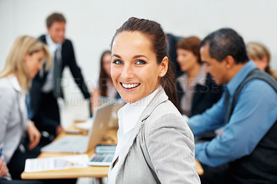 Buy stock photo Beautiful female executive with colleagues working in background