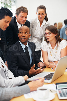 Buy stock photo Business people conversing during meeting around table