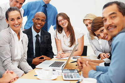 Buy stock photo Group of executives smiling with laptop on table during meeting