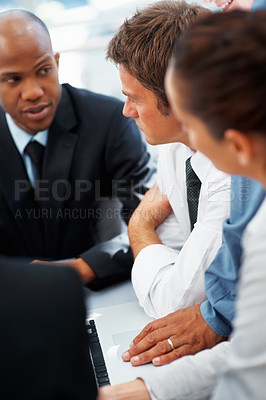 Buy stock photo Executives listening to colleague talking in meeting