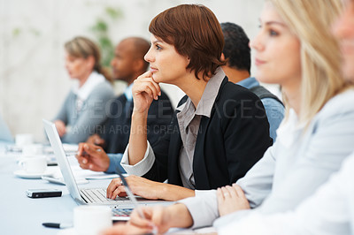 Buy stock photo Focus on cute female executive listening during meeting