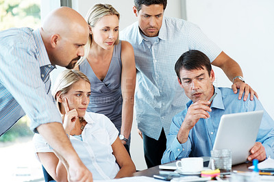 Buy stock photo Portrait of a group of successful business people working together on a laptop at office
